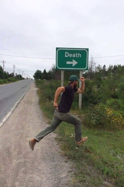 guy-running-towards-death-sign.jpg